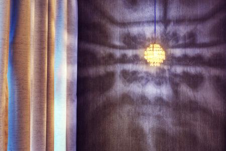 Shadow of art light reflecting on wall photo