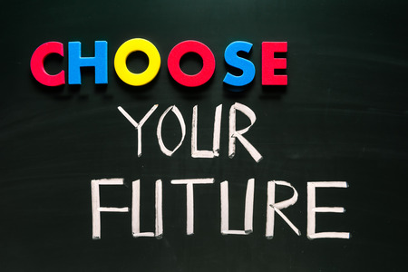 Choose your future concept, colorful words on blackboard photo