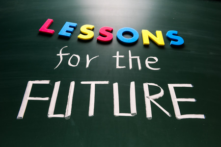 Lessons for future concept, colorful words on blackboard photo