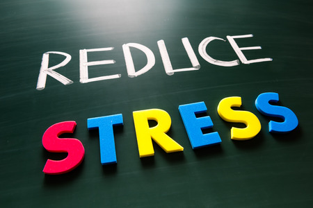 Reduce stress concept, colorful words on blackboard photo