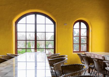 big window: Empty restaurant with big window and yellow wall