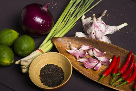 lemon grass: Fresh ingredients - lemon, onion, garlic, chili, lemon grass and tea for Thai cooking on wooden board.