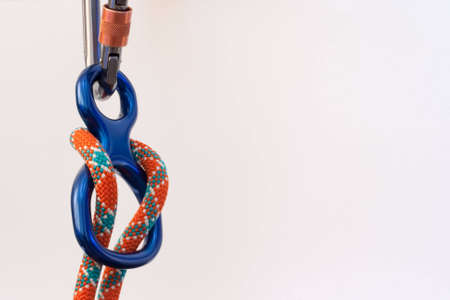 descender: Close up of carabiner and figure 8 with climbing rope Stock Photo