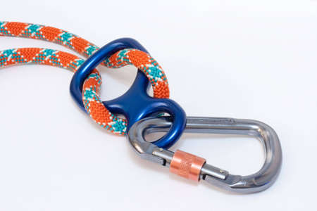 descender: Carabiner and Figure eight with climbing rope Stock Photo