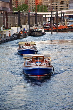 two barges on the big harbor tour on a spring day