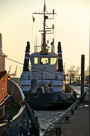tractor in the evening light in the port of hamburg Editorial