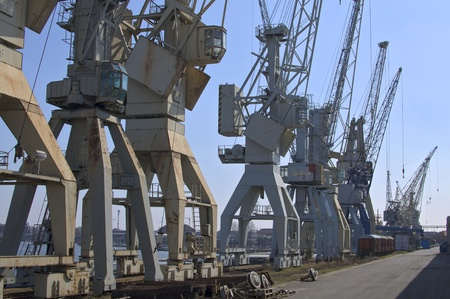 port cranes on the quayside waiting for cargo in hamburg