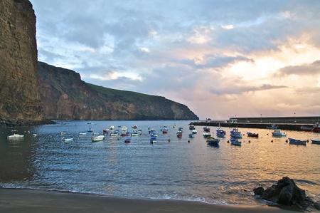 natural harbor with small fishing boats