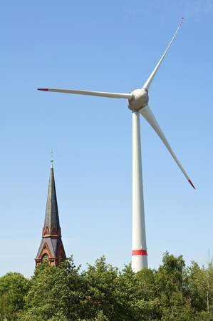 a wind power plant in the port of hamburg Stock Photo