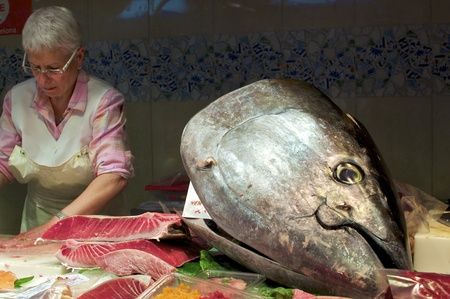 a tuna fish head as a decoration on a market stall in barcelona