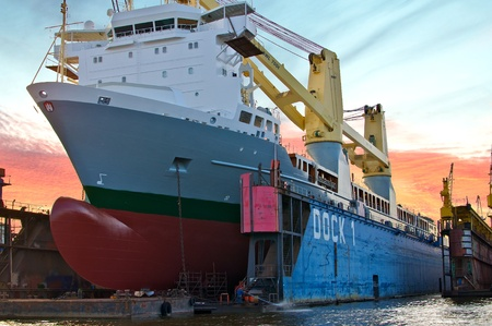 shipbuilding: a cargo ship is in dry dock for overhaul