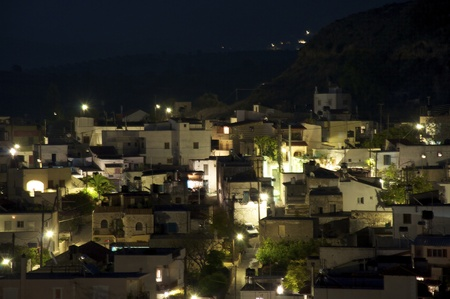 the greek village at night pitsidia Stock Photo