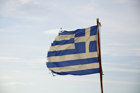 the tousled flag of greece as a symbol of the greek economic crisis