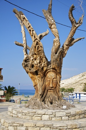 carved tree on the outskirts of matala Standard-Bild