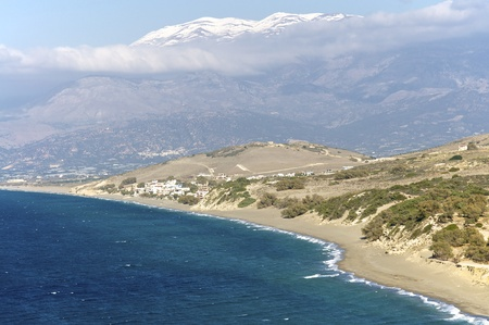 The snowy Ida Gebirge with the beach of Komos on Crete