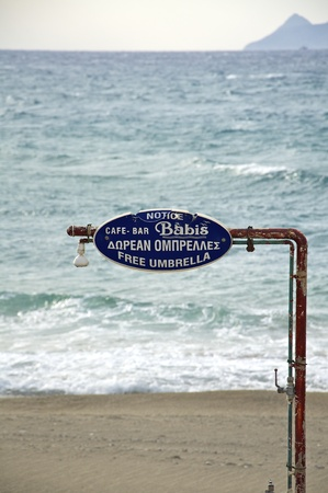 Shower with a sign on the beach of Kalamaki, Crete, Greece Stock Photo
