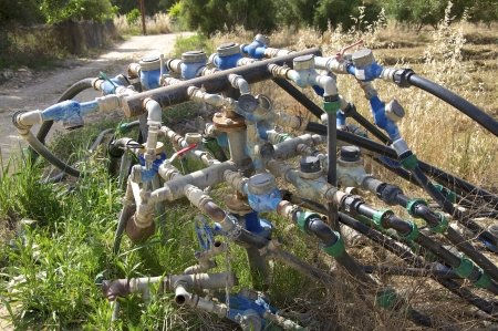 Irrigation of the olive groves on Crete Stock Photo