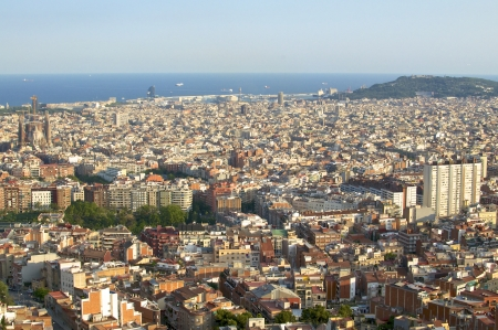 Barcelona Cityscape  View over a sea of houses in Barcelona to the Montjuic  With approx  1 6 million inhabitants, Barcelona is the capital from Catalonia photo