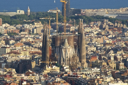 View of the construction  Sagrada Familia  and over the sea of houses in Barcelona  With approx  1 6 million inhabitants, Barcelona is the capital of Catalonia