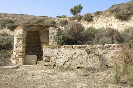 dug well: Water well in the mountains in south Crete  In earlier times the water supply in the rural areas of Crete could be guaranteed only over wells   Stock Photo