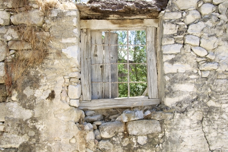 Old window at a ruin in the village Agioi Deka photo