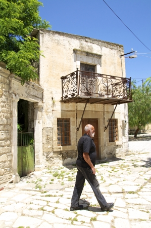 reek man at the village square in Agioi Deka on  In the village is an old church from the 12th century  The name of the village means Ten Saints referring to the ten Martyrs of Crete