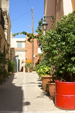 rethymno: Flowers in the narrow streets in Rethymno  Rethymno is lovely nice city with a wonderful old city part and venetian port on Crete
