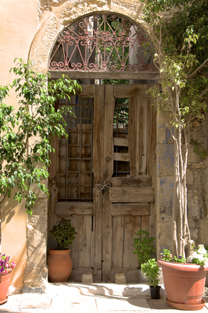 Historical Venetian doors in the old part of Rethymno  Rethymno is lovely nice city with a wonderful old city part and venetian harbor on Crete   photo