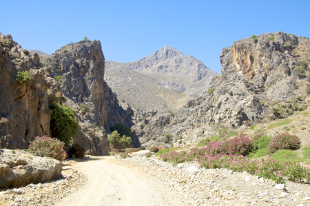 Gravel Road through the Tripiti Gorge in the Asterousia mountains near Lentas on Crete Stock Photo