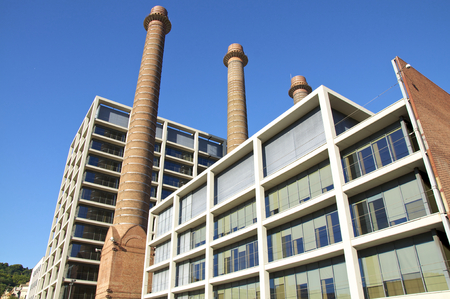 Chimneys at the Office building of the former power station in Barcelona s District Poble Sec