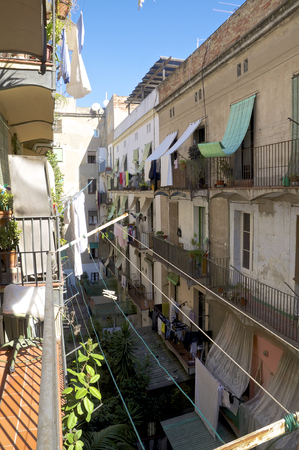 ravel: Flowers and plants and laundry on the balcony in the district Ravel in Barcelona