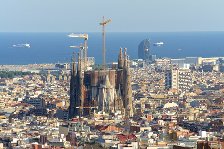 View of the construction Sagrada Familia and over the sea of houses in Barcelona. With approx. 1.6 million inhabitants, Barcelona is the capital of Catalonia