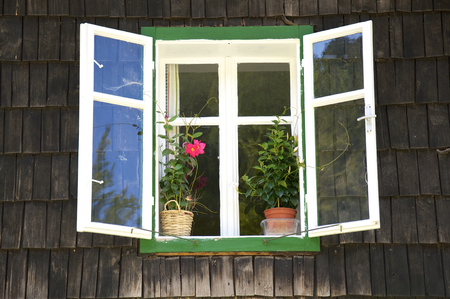 location shot: Window at a wooden house in the village Brunnbach in the Hintergebirge in upper Austria