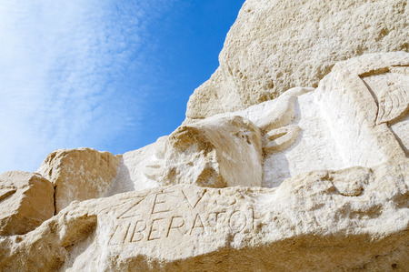chiseled: Bull sculpture from stone. In the 1970s. from hippies in the stone chiseled sculptures at the Red Beach near Matala, Crete, Greece Stock Photo