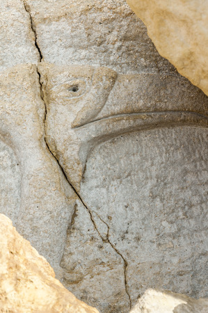 chiseled: Ibis sculpture from stone. In the 1970s. from hippies in the stone chiseled sculptures at the Red Beach near Matala, Crete, Greece