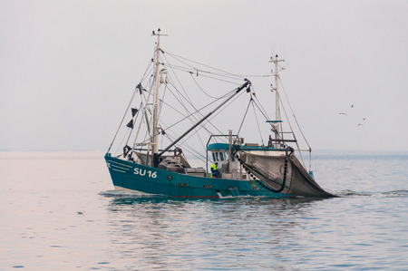 shrimp boat: Shrimper in the North Sea. It is one of the oldest cultural techniques in the fisheries in the North Sea Stock Photo
