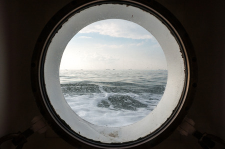 the wadden sea: Look from the porthole on the North Sea nearby the Hallig Hooge in the Wadden Sea