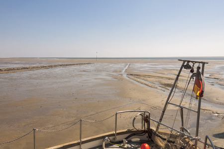 tides: Fishing Boat in the Intertidal Zone on the Hallig Langeness. Because of the tides, that boat is aground