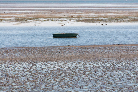 rowing boat: Rowing boat in the Wadden Sea in the North Sea nearby the Hallig Langeness Stock Photo