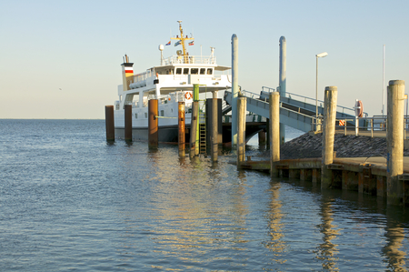 mooring bollards: Ferry at the pier on the Hallig Langeness in north Friesland, a part of north Germany