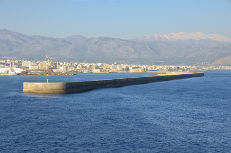 ida: Entrance to the port of Heraklion. The old Venetian harbor is guarded by a fortress. On the Ida Mountains is still snow in April. The Psiloritis with over 2500m the highest mountain on Crete.
