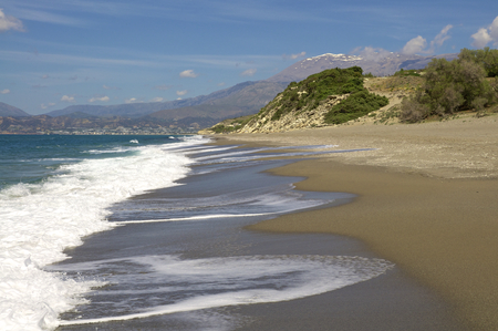 breaking waves: Breaking waves at the Komo Beach in the south west of the island Crete. In the background the IDA Mountains with the Pisiloritis as the highest elevation. Stock Photo