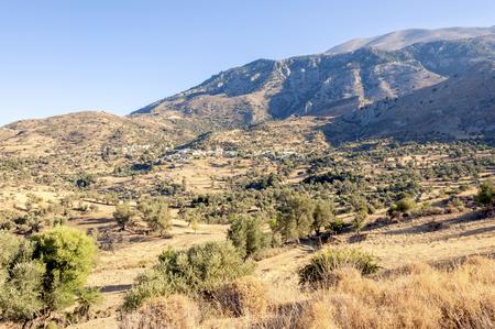 ida: On the old road to Rethymnon. View to the mountain village Kouroutes on Crete. In the background, the Ida mountain range with the Psiloritis as the highest elevation on Crete Stock Photo