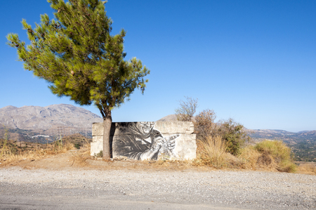 ida: Graffiti on wall on the old road to Rethymnon. The old road runs between the mountains and the Kedros IDA mountains. A beautiful scenic route
