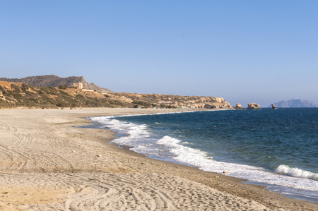 breaking waves: Breaking Waves on the beach of Triopetra on Crete. Triopetra has been named after the three rocks in the sea Stock Photo