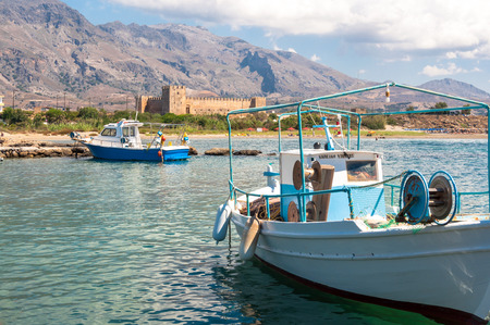 stone cutter: Fishing boats in a small harbor in Frangokastello, a small village on the south-west coast on Crete. Frangokastello is the known of a castle and as a tourist resort on Crete