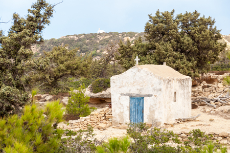 local landmark: Small greek orthodox chapel on the trail on Gavdos, Greece. In the background the chapel of Agios Ioannis. The chapels are dedicated to the Saints. In each chapel are wonderful icons to visit