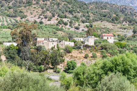 ida: The mountain village Laloumas in the southern foothills of the IDA range in south-central Crete, Greece. An old, abandoned town, where only goats and sheeps and Their Shepherds live performance