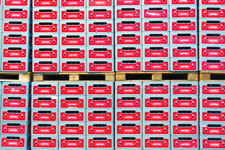 astra: Stacked crates of beer on Euro-pallets in the Astra brewery in Hamburg Altona