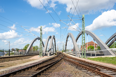 Rail track over a railroad bridge in the harbor of Hamburg. The harbor railway named Hamburg port railway, disposes of a big railway network in the harbor and around the city. Stock Photo